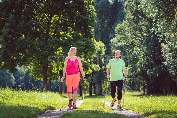 Couple doing Nordic Walking for sport Stock photo © Kzenon