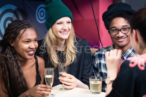 Multi ethnic friends enjoying drinks Stock photo © Kzenon
