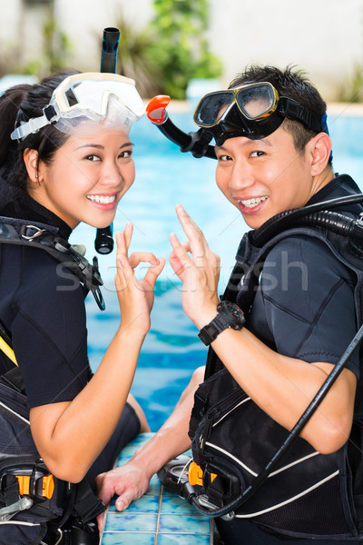 Stock photo: Teacher and student in a diving school
