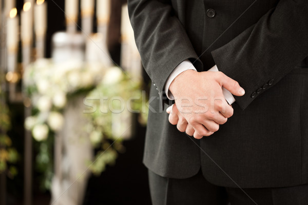 man or mortician at funeral mourning Stock photo © Kzenon