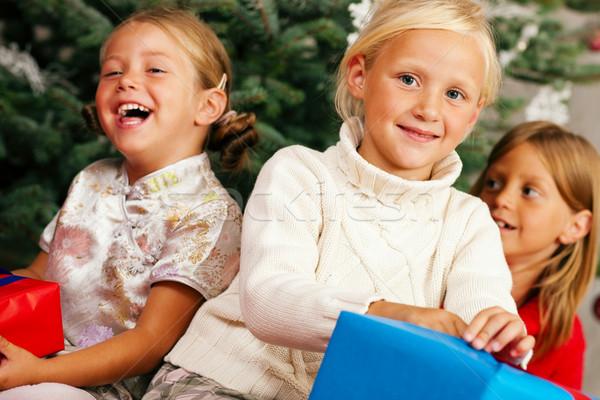 Christmas - Children with presents Stock photo © Kzenon