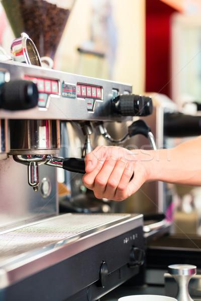Barista preparing espresso at coffee maker Stock photo © Kzenon