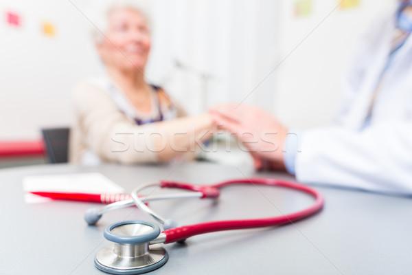 Stethoscope on doctors office desk Stock photo © Kzenon