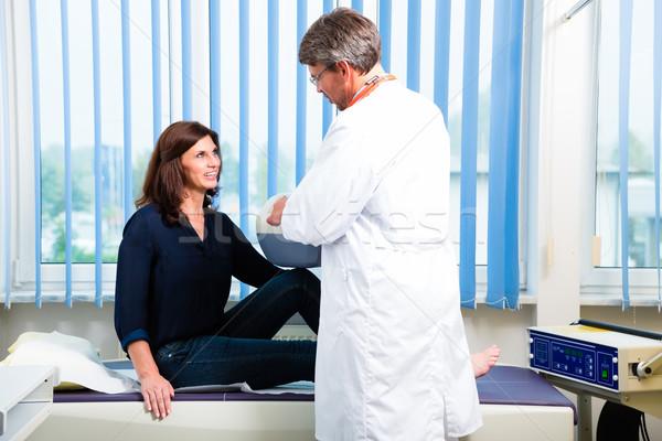 Doctor doing ultrasonic on patient in surgery Stock photo © Kzenon