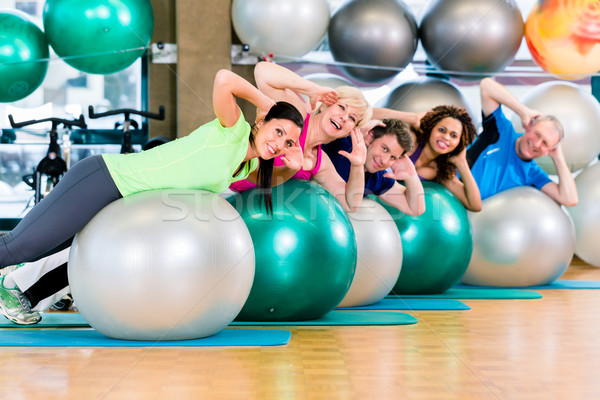 Sport and fitness in gym - diverse group of people training Stock photo © Kzenon