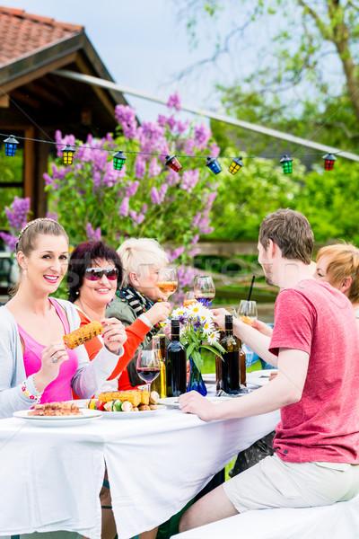 Women and men celebrating garden party Stock photo © Kzenon