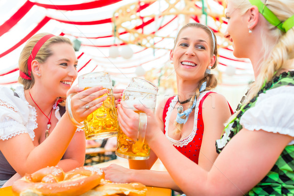 Stock photo: Friends drinking Bavarian beer at Oktoberfest