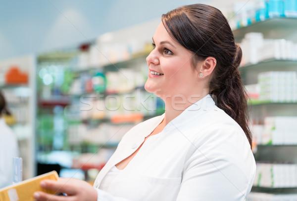 Sales woman in pharmacy or drug store Stock photo © Kzenon