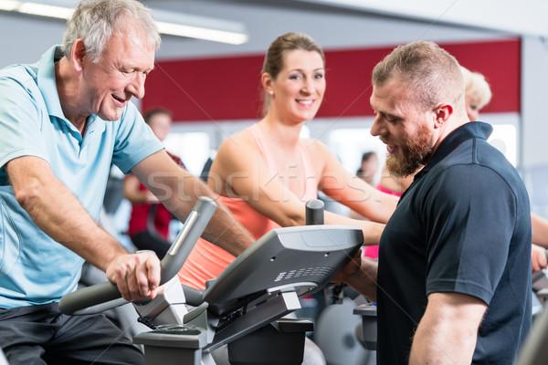 группа Личный тренер спортзал старший человека женщину Сток-фото © Kzenon