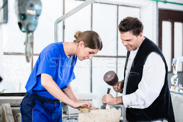 two Stonemasons carving pillar out of stone in workshop Stock photo © Kzenon