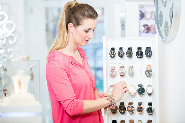 Female customer in store looking for wristwatches Stock photo © Kzenon