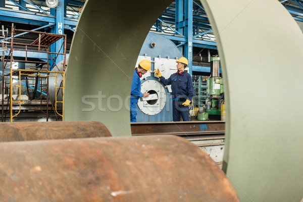 Expert checking the quality of manufactured boilers Stock photo © Kzenon