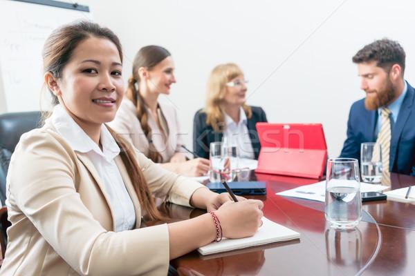 Portrait of a confident Asian business woman during a decision-m Stock photo © Kzenon