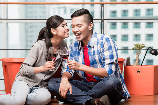 Young lovers after moving in having after work glass of wine Stock photo © Kzenon