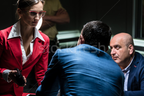 Stock photo: Dedicated female prosecutor listening to the confession of a suspect