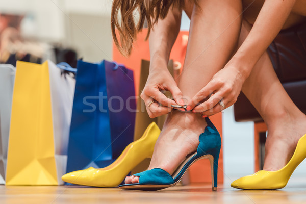 Woman trying to fit new shoes she wants to buy Stock photo © Kzenon