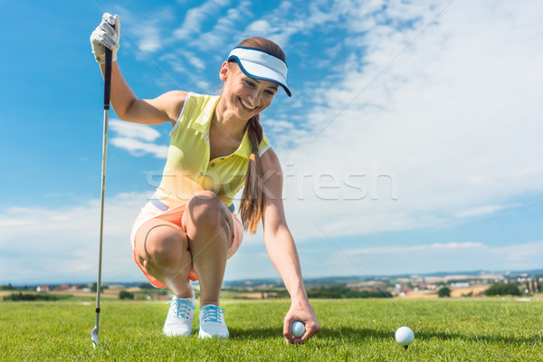 Close-up of the hand of a female player holding a ball above the golf course Stock photo © Kzenon