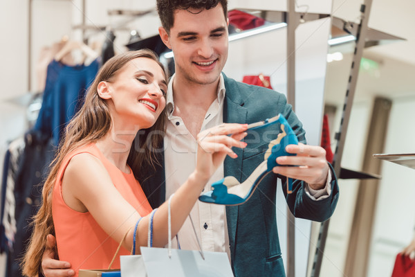 Woman with her man looking at blue shoes in store Stock photo © Kzenon