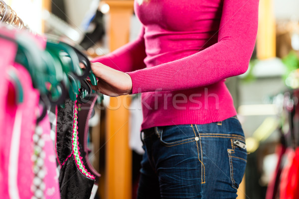 Woman is buying Tracht or dirndl in a shop Stock photo © Kzenon
