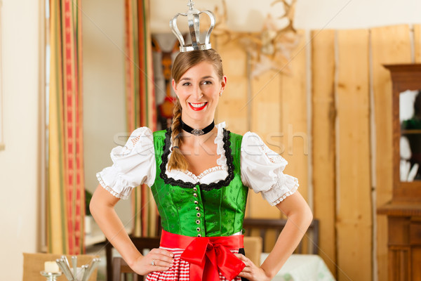 Young woman as queen in Traditional Bavarian Tracht in restaurant Stock photo © Kzenon