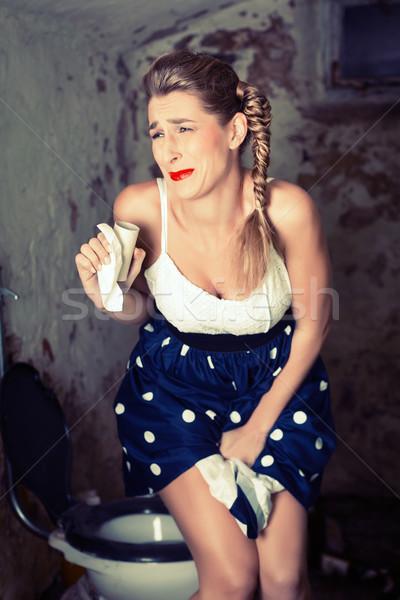 Woman needing toilet but paper is out Stock photo © Kzenon