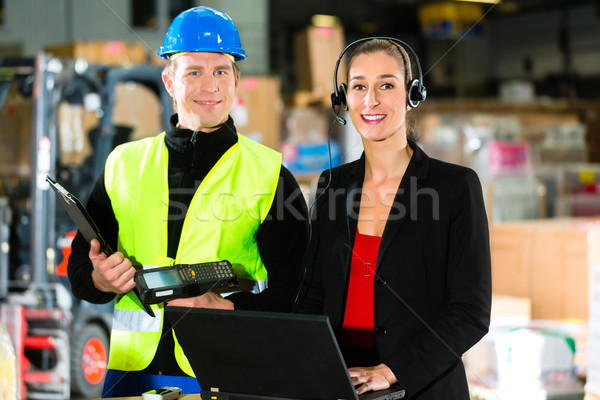 Coworkers at warehouse of forwarding company Stock photo © Kzenon