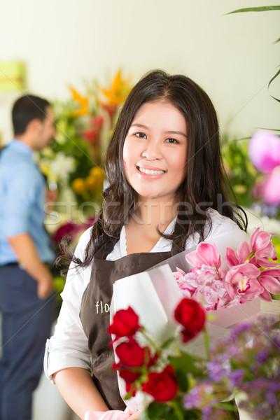 Saleswoman and customer in flower shop Stock photo © Kzenon