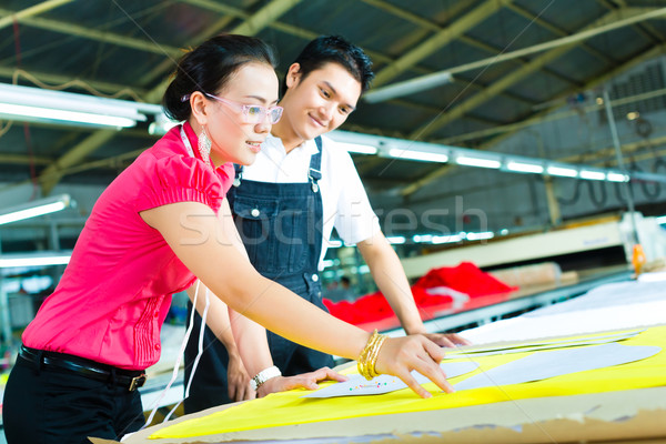 Worker and Dressmaker in a factory Stock photo © Kzenon