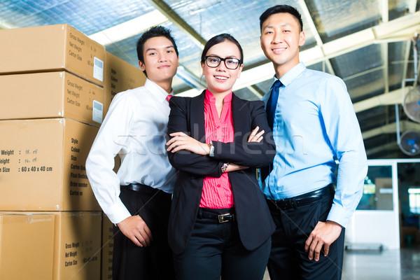 CEO and Businessmen in a warehouse Stock photo © Kzenon