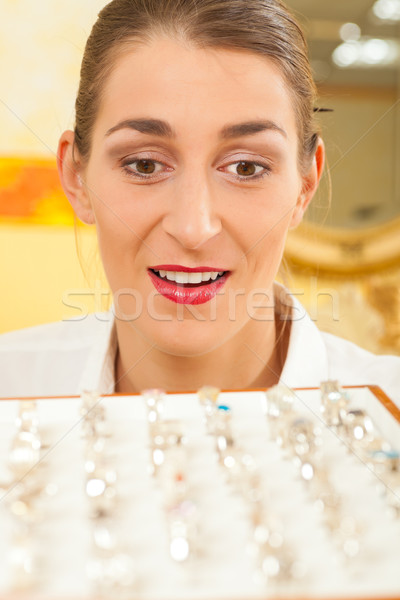 Shop assistant at the jeweller Stock photo © Kzenon