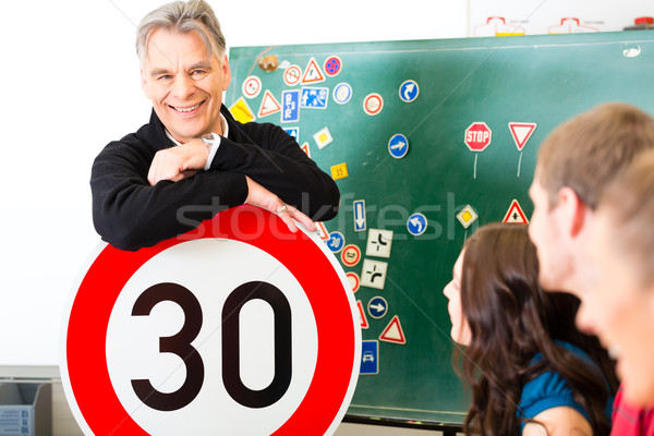 Driving instructor with his class Stock photo © Kzenon
