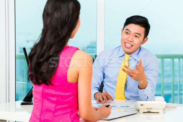 Stock photo: Asian advisor with client on financial investment