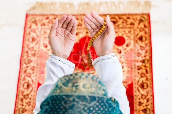 Asian Muslim woman praying with beads chain Stock photo © Kzenon