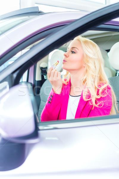 женщину макияж автомобилей покупке зеркало Сток-фото © Kzenon