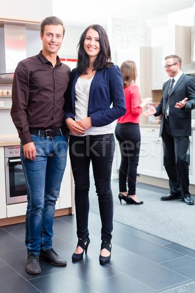 Couple in kitchen in store showroom Stock photo © Kzenon