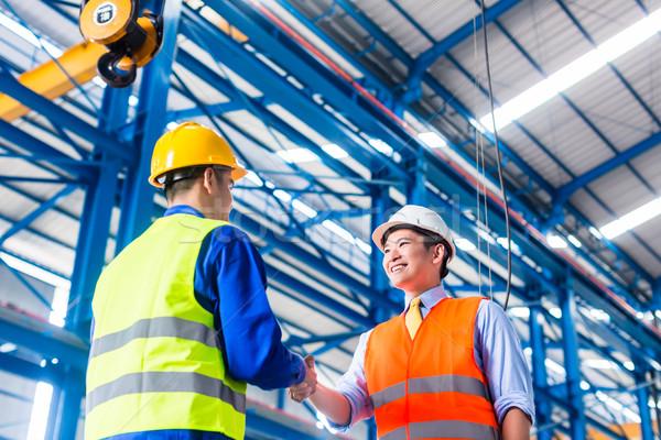 Worker and customer having agreement in factory Stock photo © Kzenon