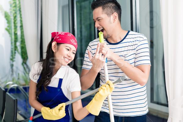Indonesian couple having fun cleaning the home Stock photo © Kzenon