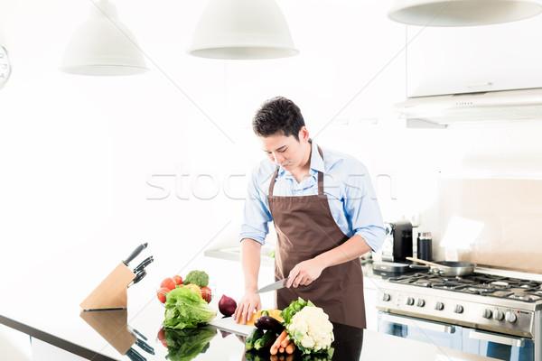 Japanese man cooking food in minimalist kitchen Stock photo © Kzenon