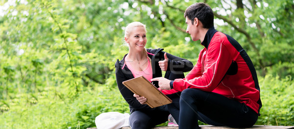 Woman with personal trainer at running evaluation Stock photo © Kzenon