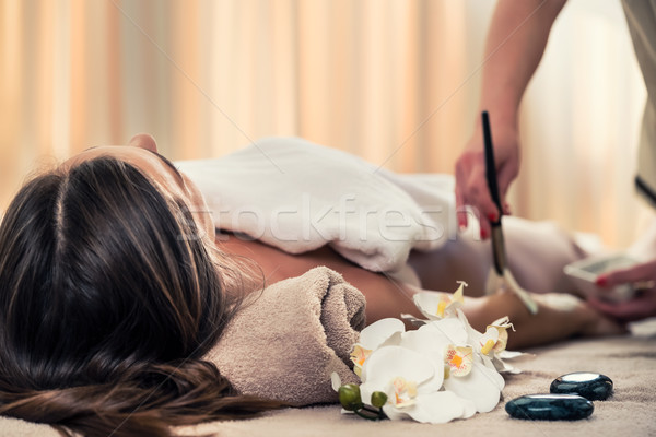 Woman lying down during Asian anti-aging treatment Stock photo © Kzenon