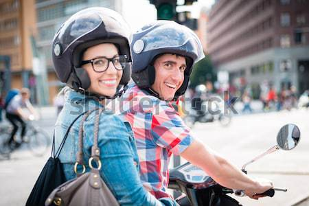 Woman sitting on pillion seat of Vespa Stock photo © Kzenon