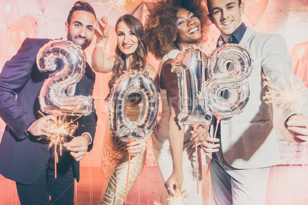 Party people women and men celebrating new years eve 2018 Stock photo © Kzenon