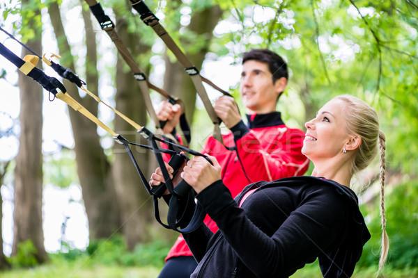 Sportos pár csúzli edző fitnessz park Stock fotó © Kzenon