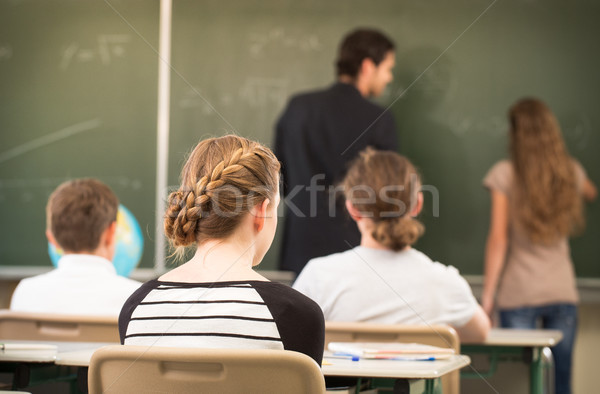 Teacher teaching or educate at the board a class in school