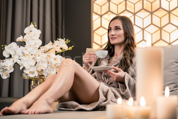 Relaxed young woman drinking herbal tea before spa treatment Stock photo © Kzenon