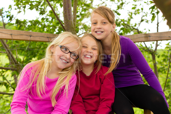 Happy children in the garden and laugh Stock photo © Kzenon