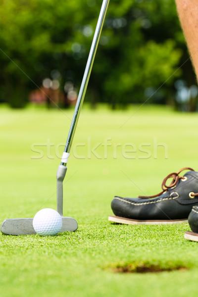 Golf player putting ball in hole Stock photo © Kzenon