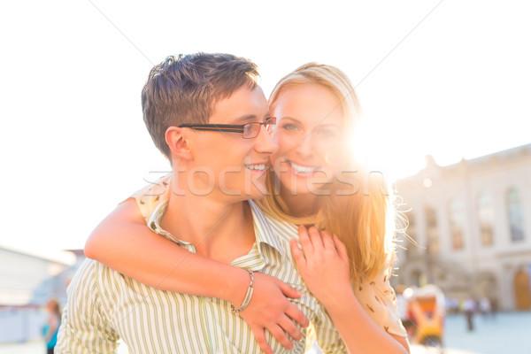 Boldog pár férfi hordoz nő háton Stock fotó © Kzenon