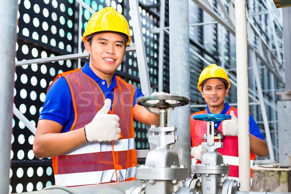 Asian Technicians or engineers working on valve  Stock photo © Kzenon