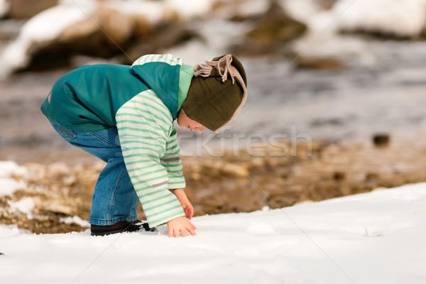 Boy with snow on river in Winter Stock photo © Kzenon